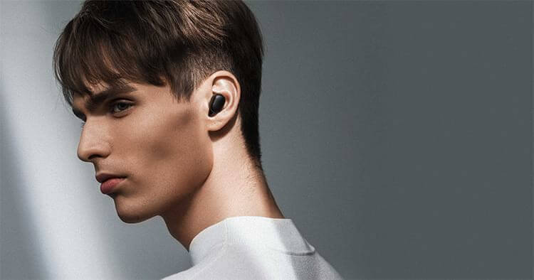 redmi airbuds on boy ear